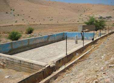 An empty Palestinian agricultural reservoir near Jiftlik in the West Bank - AI
