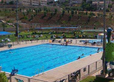 Israeli settlers in Maaleh Adumim enjoy a swim - AGG